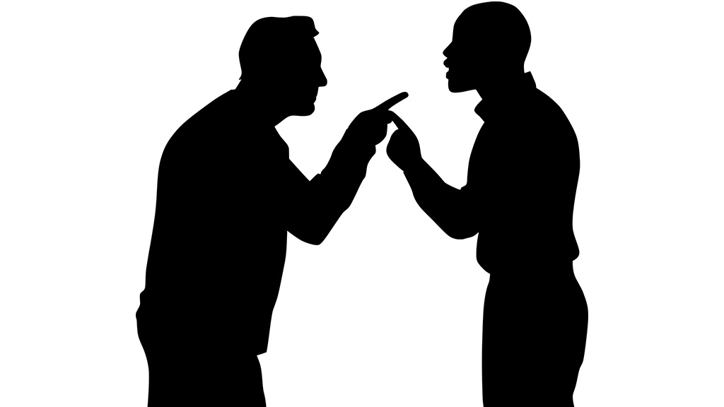 Silhouettes of two people having argument