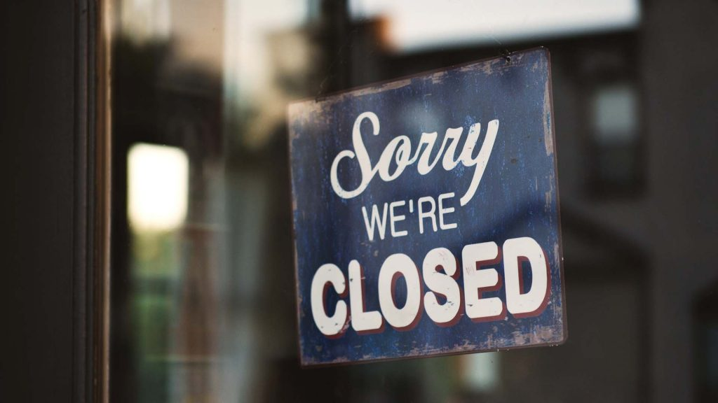 sorry we're closed sign in shop window